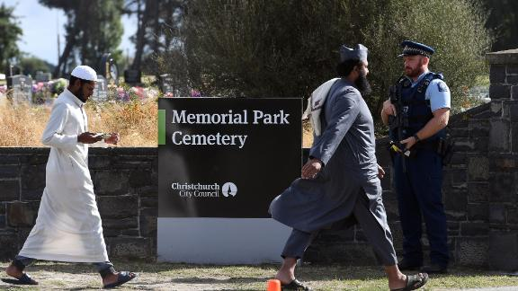 An armed policeman keeps watch as mourners arrive to attend funerals for victims killed in the mosque massacre in Christchurch, New Zealand.