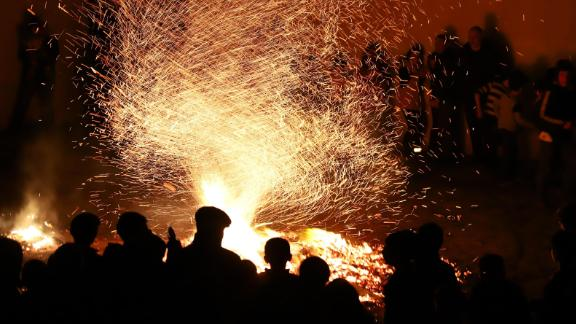 People gather around a bonfire on March 12, 2019, as part of the Nowruz celebrations in Baku, Azerbaijan.