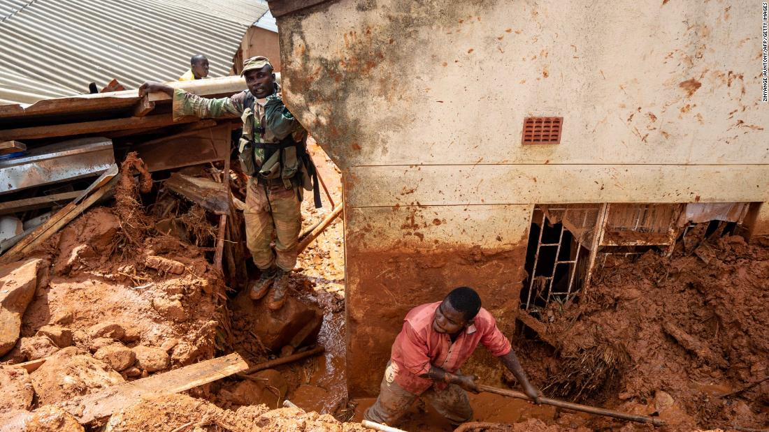 Soldiers help residents retrieve their lost belongings on Tuesday, March 19, in Chimanimani, Zimbabwe.
