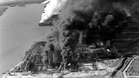 Refineries and oil storage tanks from the Monsanto chemical plant burn along the waterfront in Texas City, Texas, on April 16, 1947.