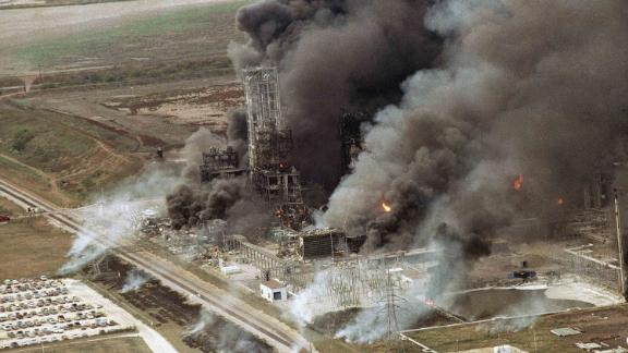 The Phillips chemical plant in Pasadena, Texas on fire, Monday, Oct. 23, 1989 after explosions ripped through it.