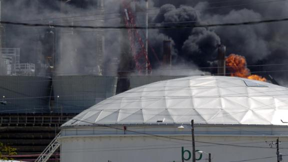 Flames erupt from the BP Amoco PLC oil refinery plant in Texas City, Texas after an explosion.