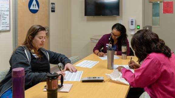 Nurses at the emergency psychiatric unit in San Pedro, known as the Outpatient Behavioral Health Center, discuss the status of patients at the facility.
