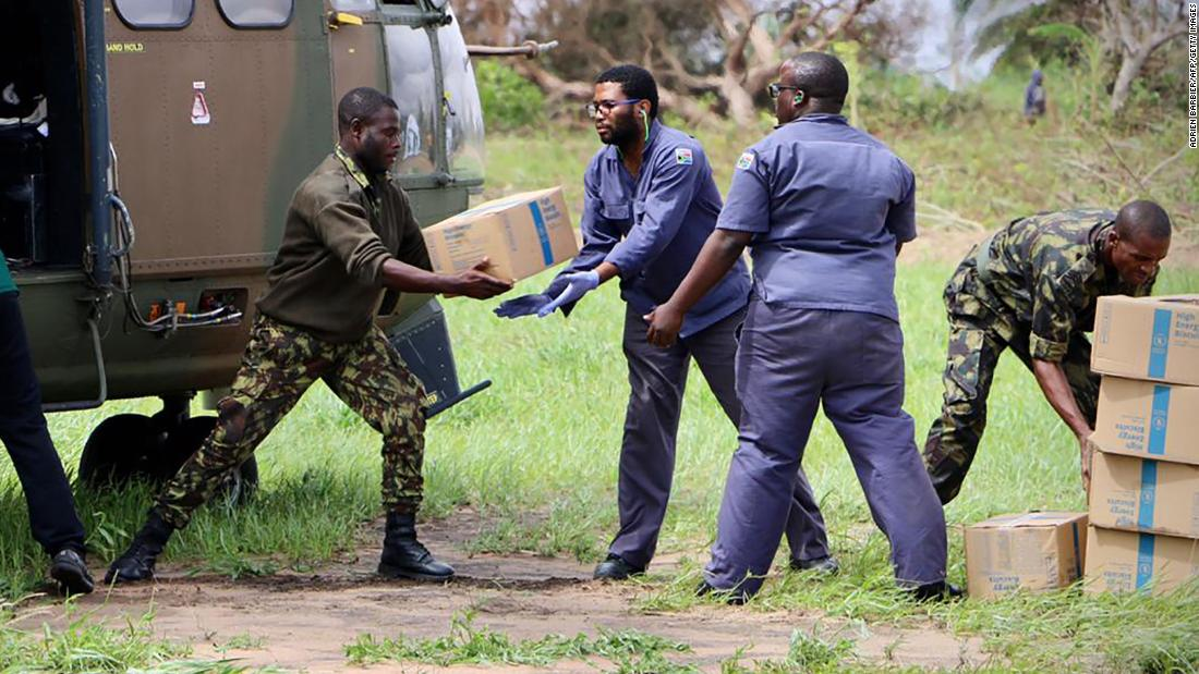 South Africa National Defense Forces personnel deliver relief aid in Buzi on March 20.