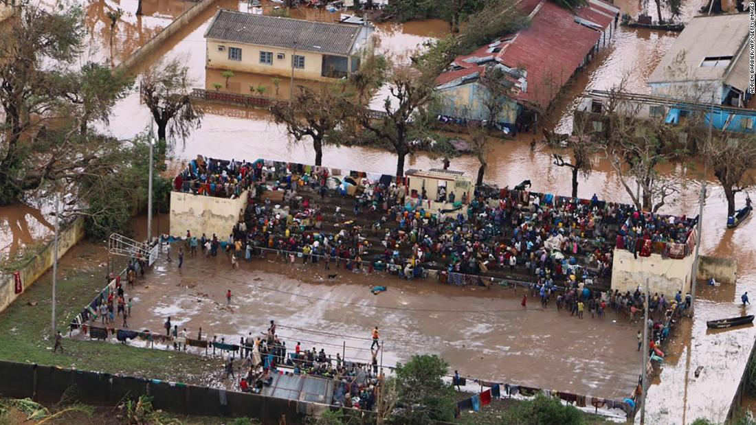 Residents stranded on the stands of a stadium in a flooded area of Buzi, Mozambique, on March 20.