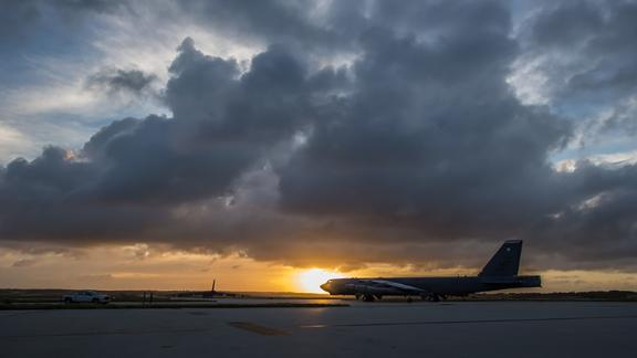 A B-52 Stratofortress taxis down the flightline as the sun sets over Andersen Air Force Base, Guam, March 18, 2019.