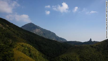 In this photo taken on October 7, 2018, the Big Buddha (right) is seen at Ngong Ping, Lantau Island in Hong Kong.