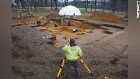 Tents with heaters are used to thaw frozen ground before archaeologists can begin excavation.
