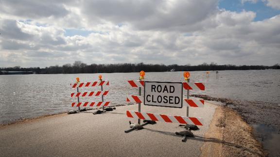 """FREEPORT, ILLINOIS - MARCH 18: A road is covered with floodwater from the Pecatonica River on March 18, 2019 in Freeport, Illinois. Several Midwest states are battling some of the worst flooding they have experienced in decades as warming weather, rain and snow melt from the recent """"bomb cyclone"""" has inundated rivers and streams. At least two deaths have been linked to the flooding.(Photo by Scott Olson/Getty Images)"""