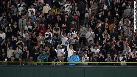 Fans cheer on Ichiro despite his ground out in the fourth inning.