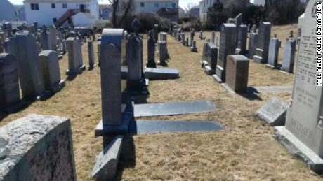 Fifty-nine gravesites at a Jewish cemetery in Fall River, Massachusetts, were desecrated with swastikas and anti-Semitic phrases, police said.