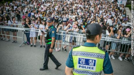 Fans wait to see K-Pop stars outside a concert in Suwon, South Korea, in 2016.