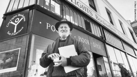 Poet Lawrence Ferlinghetti poses on Monday, Jan. 15, 1988 in San Francisco in front of the North Beach bookstore he founded more than 35 years ago. The San Francisco Board of Supervisors accepted 13 of Ferlinghettiís recommendations on Thursday to change local street names after 15 of San Franciscoís best known artists and writers. (AP Photo)