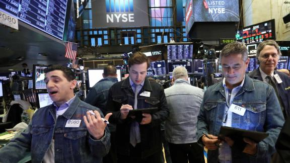 A trader wears Levi's clothing during the Levi Strauss & Co. IPO on the floor of the New York Stock Exchange.