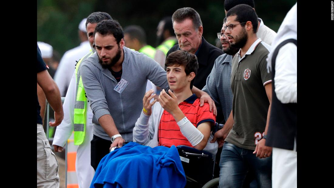 Zaed Mustafa, center, attends the funerals of his brother Hamza and father Khalid Mustafa, who were both killed in the Friday, March 15, mosque shootings in Christchurch, New Zealand .