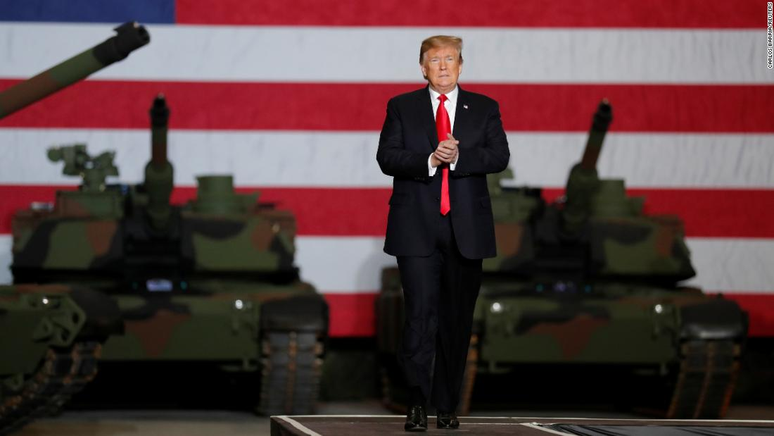 President Donald Trump speaks to workers in front of Army tanks on display at the Joint Systems Manufacturing Center , the country's only remaining tank manufacturing plant, in Lima, Ohio, on Wednesday, March 20.