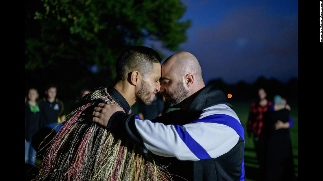 "A Muslim man, right, and another local perform a traditional Maori ""hongi"" greeting, a touching of noses, after Muslims prayed in front of the Al Noor mosque while being protected by locals, following a mass haka in Christchurch, New Zealand, on Wednesday, March 20. The ceremony came five days after the twin mosque shootings claimed the lives of 50 people."