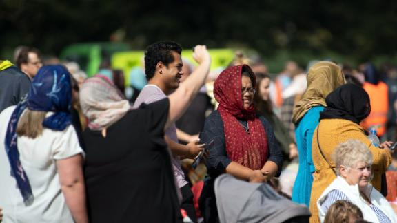 Female members of the public with head scarfs gather for the call to prayer and the moments silence at Hagley Park.