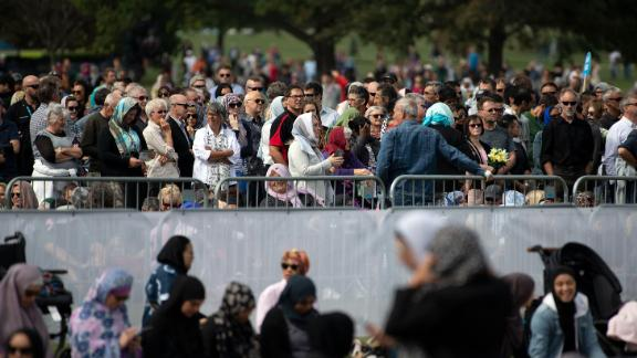 People gather for congregational Friday prayers by the Muslim community and a two-minute observation of silence at Hagley Park.