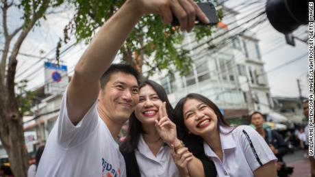 Future Forward Party leader Thanathorn Juangroongruangkit seen taking selfie with students in front of the Suan Sunandha Rajabhat Dusit University in Bangkok.
