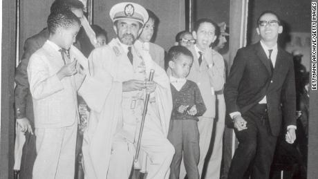Emperor Haile Selassie and his grandchildren are waiting for an Ethiopian Airlines jet.