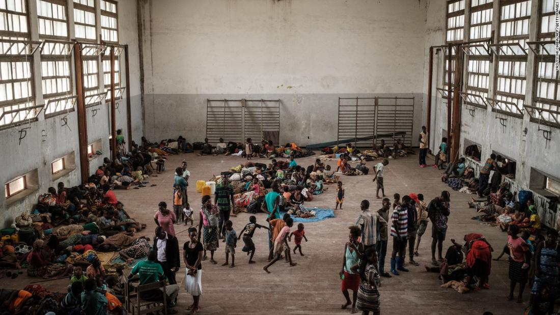 People from the isolated district of Buzi take shelter in the Samora M. Machel secondary school used as an evacuation center in Beira on March 21.