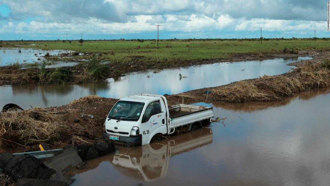 A vehicle is submerged in floodwaters on March 21 after it got swept away by Cyclone Idai in Nyamatanda, Mozambique.