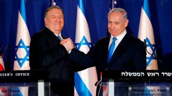 U.S. Secretary of State Mike Pompeo, left, shakes hands with Israeli Prime Minister Benjamin Netanyahu, during their visit to Netanyahu
