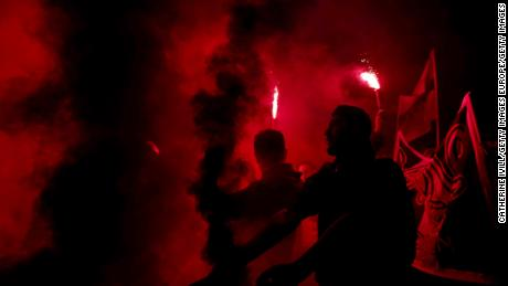 PSG fans light flares and smoke bombs outside the stadium after the UEFA Women's Champions League tie against Chelsea Women.