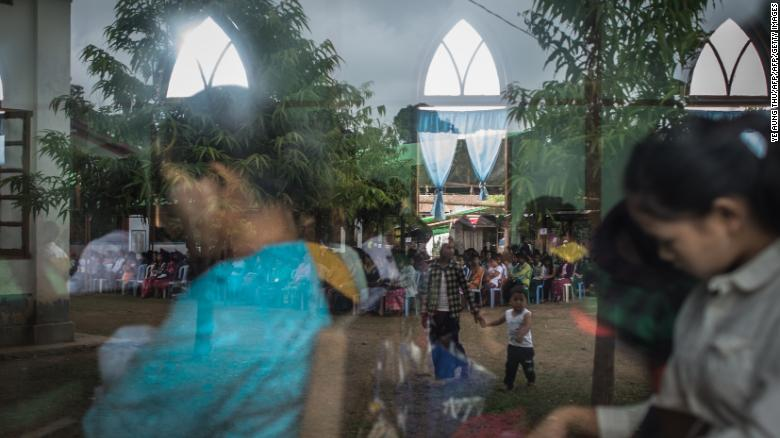 In this picture taken on May 13, 2018, internally displaced people and local villagers attend a church service in Myitkyina, Kachin state.