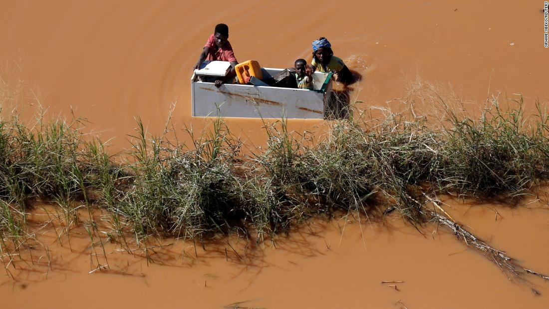 A child is transported via a refrigerator in flooding caused by Cyclone Idai in Buzi, Mozambique, on Thursday, March 21.