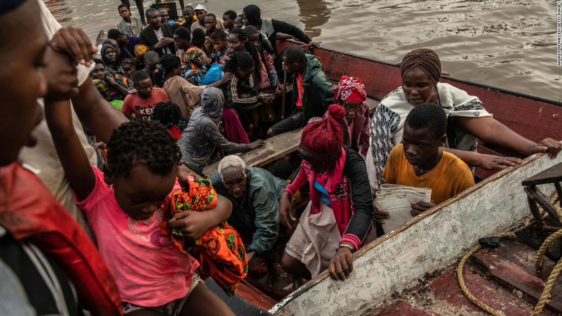 People unload from a boat in Beira, Mozambique, on Friday, March 22, after being rescued. Thousands remain stranded after Cyclone Idai hit.