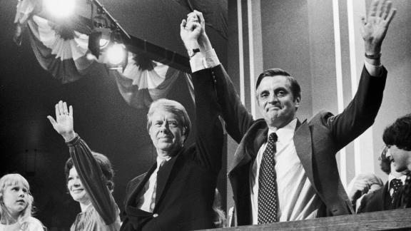 After becoming the Democratic Party's presidential nominee in 1976, Carter raises hands with running mate Walter Mondale at the Democratic National Convention in New York. Standing to Carter's right is his wife, Rosalynn, and their daughter, Amy. Carter ran as a Washington outsider and someone who promised to shake up government.