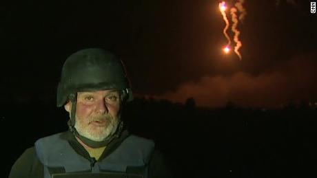 Flares illuminate Syrian horizon behind CNN reporter