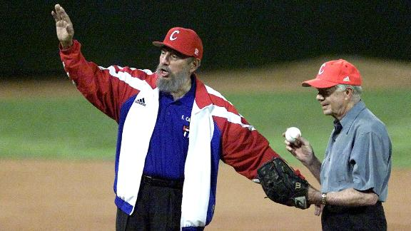 Cuban President Fidel Castro calls for time as Carter prepares to throw the first pitch at a baseball game in Havana, Cuba, in May 2002.