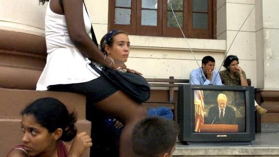 Students at the University of Havana listen to Carter outline his vision for improved relations between the United States and Cuba on May 14, 2002. The speech was broadcast live and uncensored on Cuban state television.