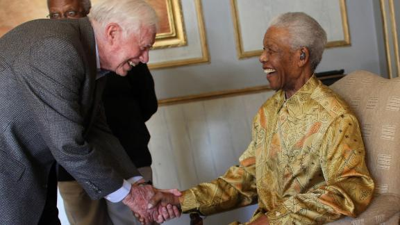Carter greets South African leader Nelson Mandela in Johannesburg in May 2010.