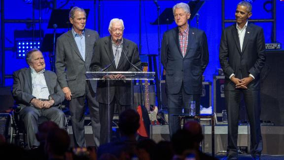Carter, center, speaks along side former US Presidents George H. W. Bush, George W. Bush, Bill Clinton and Barack Obama as they attend the Hurricane Relief concert in College Station, Texas, in October 2017.