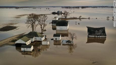 "CRAIG, MISSOURI - MARCH 22:  Floodwater surrounds a farm on March 22, 2019 near Craig, Missouri. Midwest states are battling some of the worst floodings they have experienced in decades as rain and snowmelt from the recent ""bomb cyclone"" has inundated rivers and streams. At least three deaths have been linked to the flooding.  (Photo by Scott Olson/Getty Images)"
