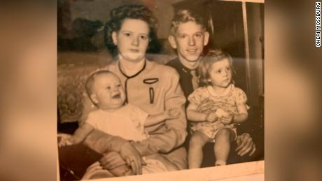 Betty and Lynn Hadfield hold their children, Kent, 3 months, and Mary Ann, 2, in 1944.