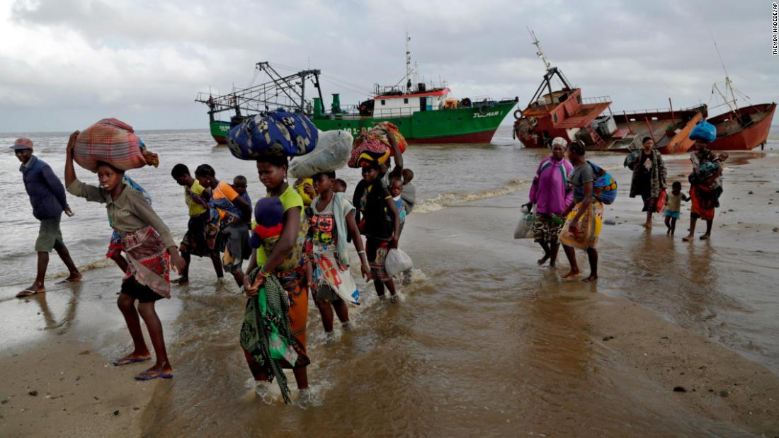 Displaced families arrive after being rescued from a flooded area of Buzi district in Mozambique on March 23.