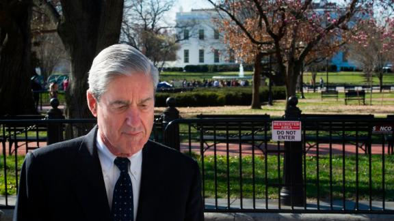 Special Counsel Robert Mueller walks past the White House after attending services at St. John