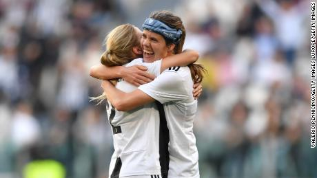 Sofie Pedersen (right) celebrates scoring the winner against Fiorentina