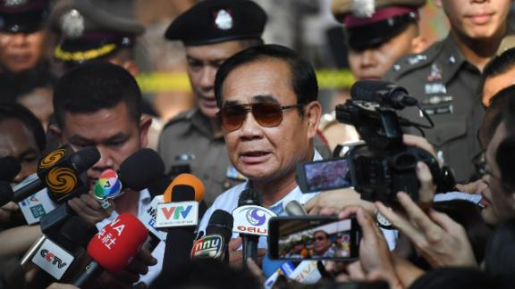 Thailand's Prime Minister Prayut Chan-O-Cha talks to the media after voting at a polling station in Bangkok on March 24, 2019 during Thailand's general election. (Photo by Lillian SUWANRUMPHA / AFP)        (Photo credit should read LILLIAN SUWANRUMPHA/AFP/Getty Images)