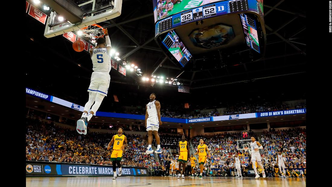 Duke forward RJ Barrett dunks as teammate Zion Williamson celebrates during a game against the North Dakota State Bison in the first round of the 2019 NCAA Men's Basketball Tournament at Colonial Life Arena on Friday, March 22.