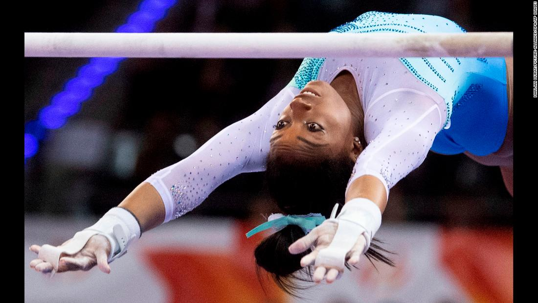 Simone Biles of the United States performs on the uneven bars during the all-around competition at the International Gymnastics Federation World Cup in Stuttgart, Germany on March 17.