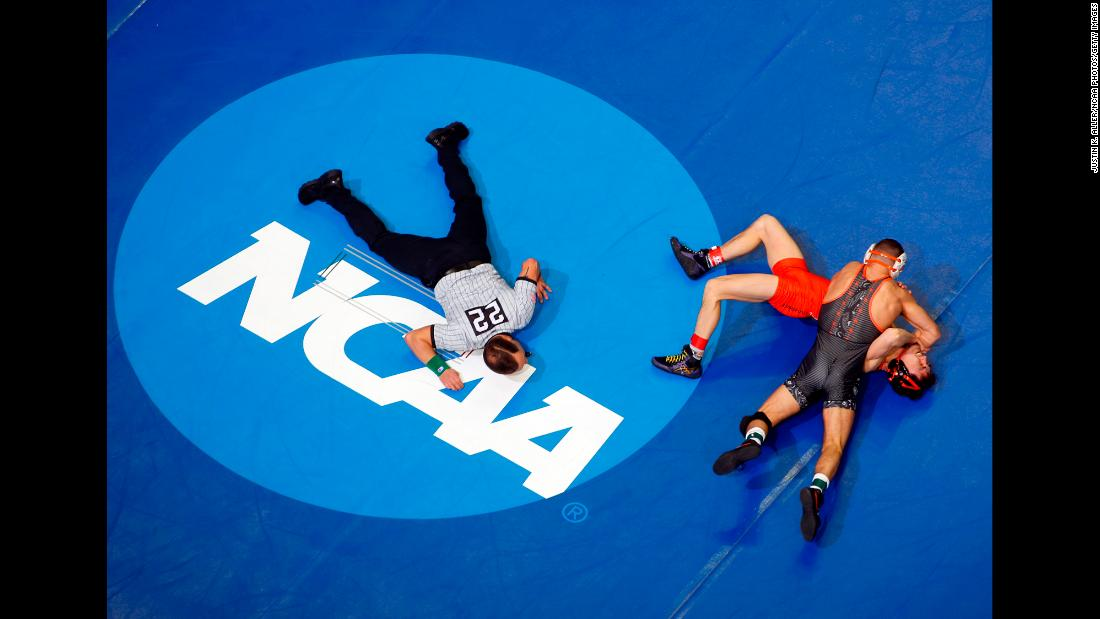Nicholas Piccininni of Oklahoma State wrestles Korbin Meink of Campbell during the Division I Men's Wrestling Championship held at PPG Paints Arena in Pittsburgh on Thursday, March 21.