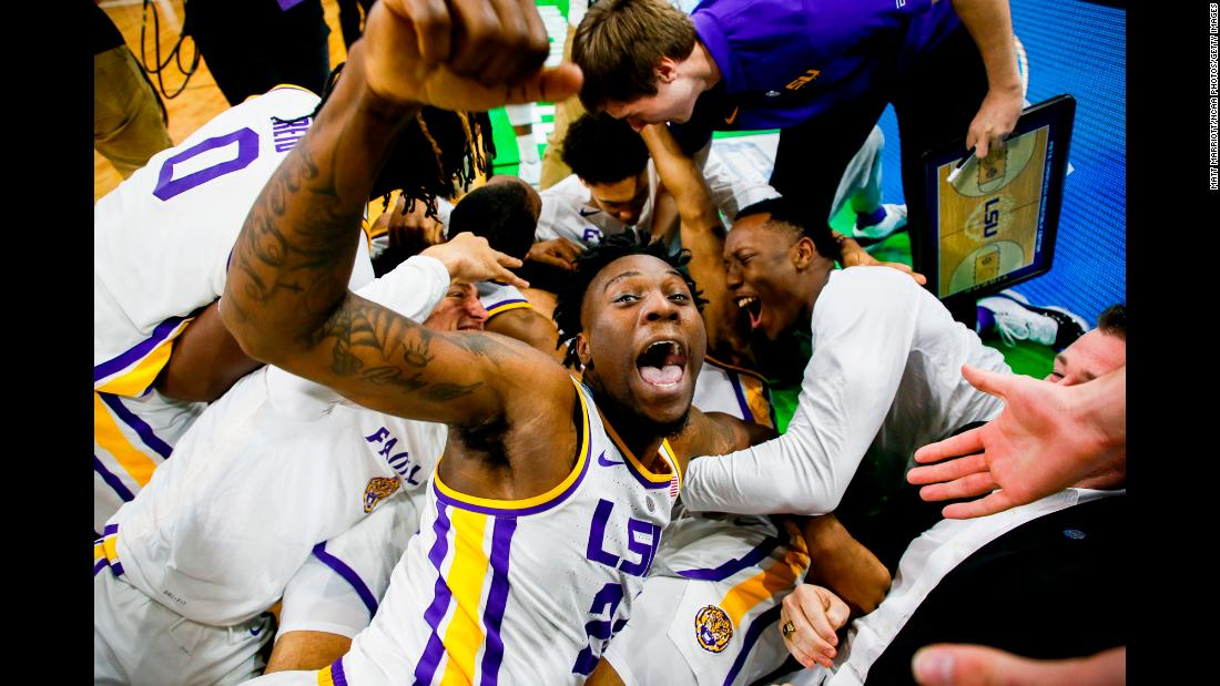 "LSU Tigers forward Emmitt Williams celebrates with his teammates after defeating the Maryland Terrapins in the second round of the NCAA Men's Basketball Tournament on Saturday, March 23, in Jacksonville, Florida. LSU sophomore Tremont Waters hit a <a href=""https://bleacherreport.com/articles/2827405-video-watch-lsus-tremont-waters-hit-game-winning-layup-vs-maryland"" target=""_blank"">game-winning shot</a> in the final seconds of the game to advance the Tigers to the Sweet 16."