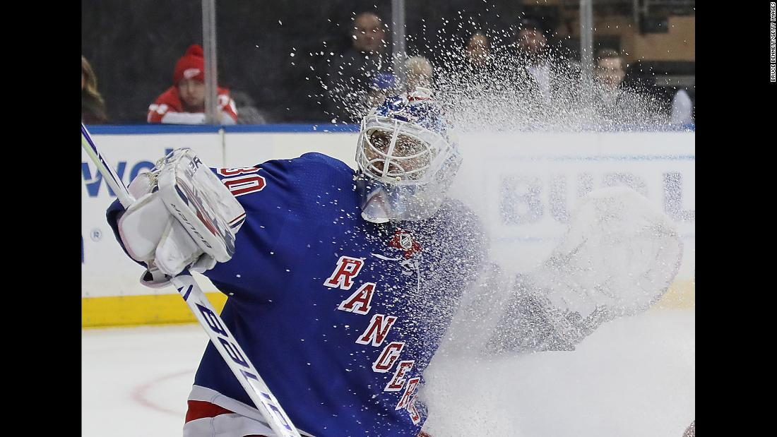 New York Rangers goaltender Henrik Lundqvist gets sprayed with ice in front of the net during the first period of a game against the Detroit Red Wings at Madison Square Garden on Tuesday, March 19.