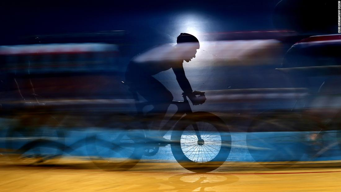 A cyclist competes during the Team Elimination on day three of the Phynova Six Day Manchester cycling event in Manchester, England on Sunday, March 24.